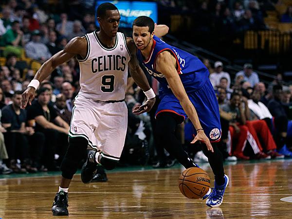76ers guard Michael Carter-Williams drives to the basket against Celtics guard Rajon Rondo. (Charles Krupa/AP)