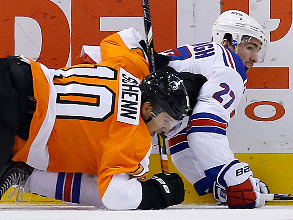 The Flyers´ Brayden Schenn and the Rangers´ Ryan McDonagh collide. (Matt Slocum/AP)