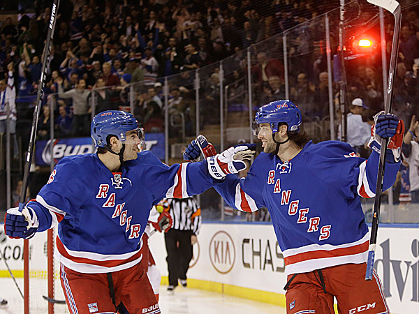 The Rangers´ Benoit Pouliot and Derick Brassard. (Frank Franklin II/AP)