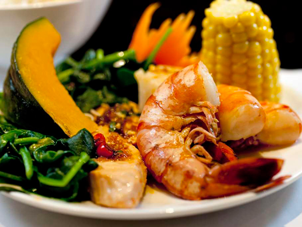 Seafood shabu is salmon, cod, scallops, shrimp, clams, vegetables.