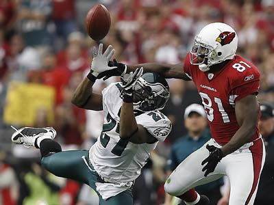 The Cardinals announced Wednesday that they are listening to trade offers for wide receiver Anquan Boldin, seen here defended by the Eagles´ Quintin Mikell in the NFC Championship game. (David Maialetti / Staff Photographer)