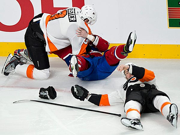 Flyers defenseman Kent Huskins left Monday night´s game against the Canadiens with a concussion. (Paul Chiasson/The Canadian Press/AP)