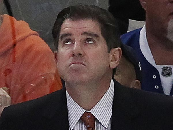 Flyers coach Peter Laviolette was in a somber mood after his team's 7-3 win in Montreal on Monday night. (Michael Bryant/Staff Photographer)