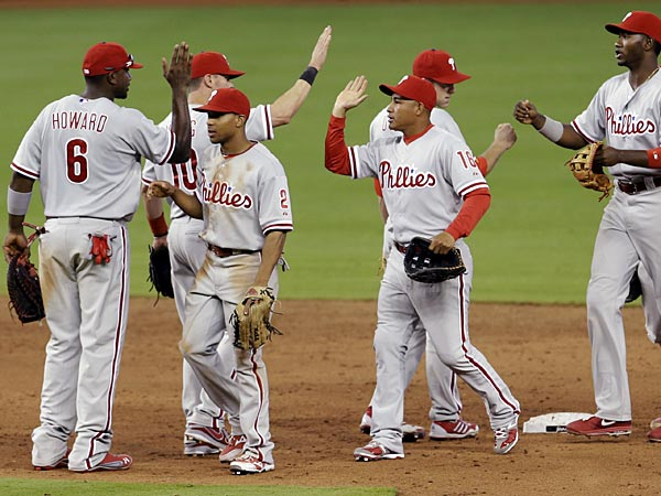 Philadelphia Phillies players celebrate their 2-1 win against the<br />Miami Marlins after a baseball game in Miami, Sunday, April 14, 2013.<br />(AP Photo/Alan Diaz)