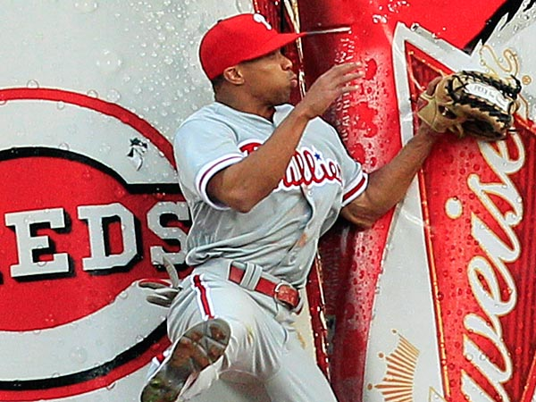 Philadelphia Phillies center fielder Ben Revere catches a fly ball hit<br />by Cincinnati Reds&acute; Ryan Hanigan in the fifth inning on Monday, April 15, 2013, in Cincinnati. (Al Behrman/AP)