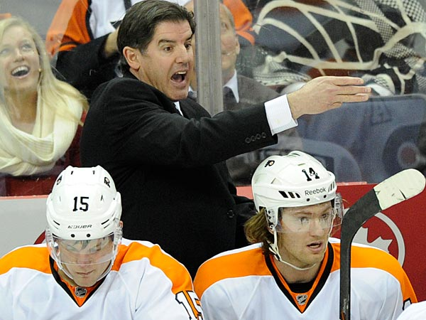 Philadelphia Flyers head coach Peter Laviolette, top left, gestures during the third period of an NHL hockey game against the Washington Capitals, Friday, Feb. 1, 2013, in Washington. The Capitals won 3-2. (AP Photo/Nick Wass)