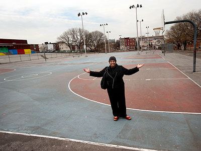 Judith Robinson, a North Philadelphia community activist, stands on the parcel the school district has given to the city for $1. (Sharon Gekoski-Kimmel / Staff Photographer)