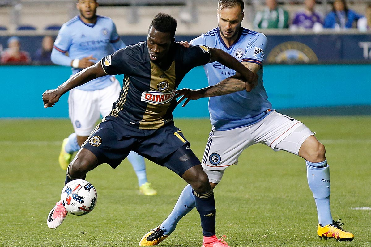 Union forward C.J. Sapong goes after the ball against New York City FC defender Maxime Chanot.