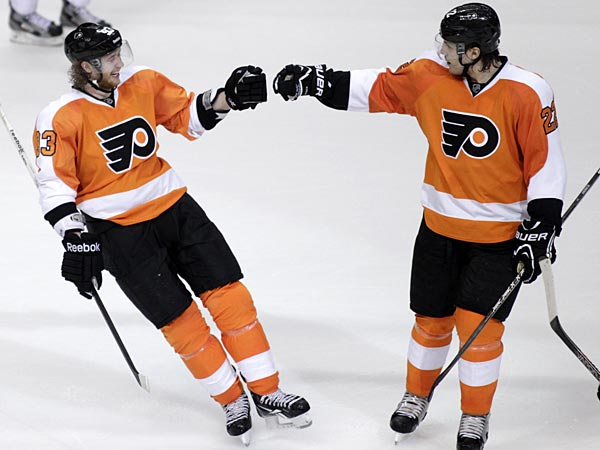Philadelphia Flyers&acute; Jakub Voracek (93) of Czech Republic celebrates<br />with Luke Schenn (22) after scoring against New York Rangers&acute;  the in<br />the third period of an NHL hockey game, Tuesday, April 16, 2013 in<br />Philadelphia. The Flyers won 4-2. (AP Photo/ H. Rumph Jr)