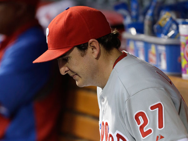 John Lannan sits in the dugout after being taken out in the second inning of a baseball game against the Cincinnati Reds, Wednesday, April 17, 2013, in Cincinnati. (Al Behrman/AP)