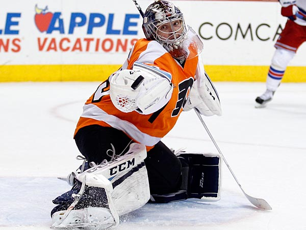 Flyers&acute; goalie Steve Mason saves the puck off his glove during the<br />first period against the New York Rangers on Tuesday, April 16, 2013. <br />(Yong Kim / Staff Photographer )