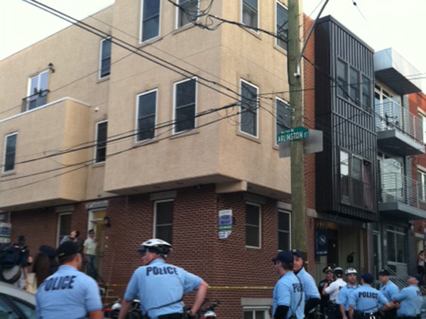 It´s unclear how the woman fell from the roof, on 18th Street near Norris -- a few blocks west from Temple University´s Main Campus on a block where numerous students rent housing. (Steve Falk / Daily News)