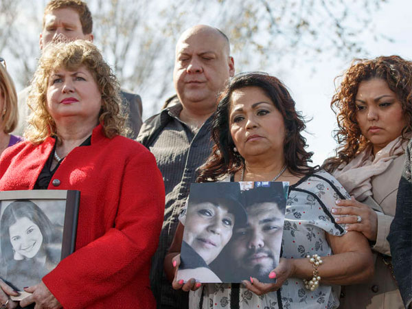 Families of victims of General Motors safety defects in small cars hold photos of their loved ones as they gathered on Capitol Hill in Washington earlier this month. (File photo: J. Scott Applewhite / Associated Press)