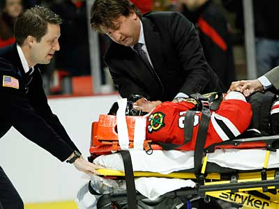 Blackhawks forward Marian Hossa is taken off the ice on a stretcher after an elbow from Coyotes forward Raffi Torres. (AP Photo/Daily Herald, Steve Lundy)