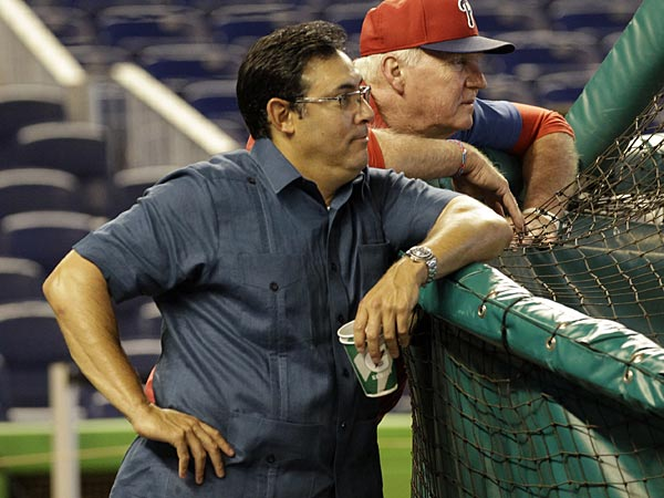 Philadelphia Phillies manager Charlie Manuel, right, and general manager Ruben Amaro, Jr. watch batting practice before an MLB baseball game against the Miami Marlins in Miami, Saturday, April 13, 2013. (AP Photo/Alan Diaz)