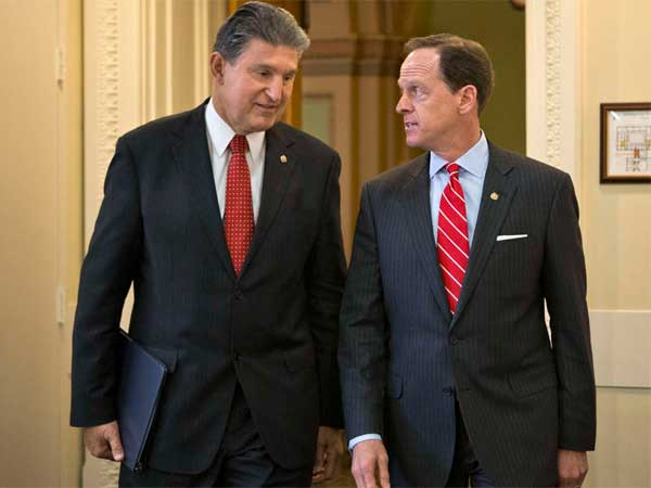 The vote on the bill, backed by Sens. Joe Manchin (left) and Pat Toomey, was 54-46, short of the 60 votes needed. (Associated Press)