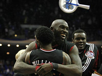 Lou Williams, Maurice Evans and Samuel Dalembert celebrate the Sixers´ upset win as Magic fans express their displeasure by throwing objects onto the court. (Ron Cortes/Staff Photographer)