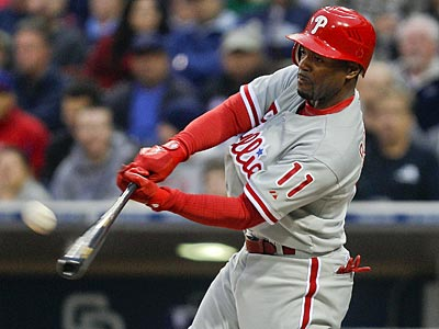 Jimmy Rollins was in a group of four taking extra hitting before the game tonight.  (Lenny Ignelzi/AP)