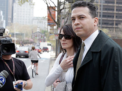 A jury found former police inspector Daniel Castro (right, with unidentified woman) guilty Wednesday of one count of lying to the FBI but deadlocked on 8 other counts. The jury also found him not guilty on one count of extortion. (David Maialetti / Staff Photographer)