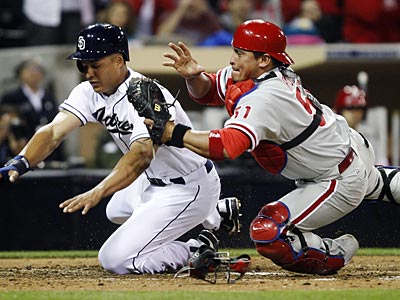 Phillies catcher Carlos Ruiz will sit out Friday night´s game against the Padres with a sore wrist. (Lenny Ignelzi/AP)