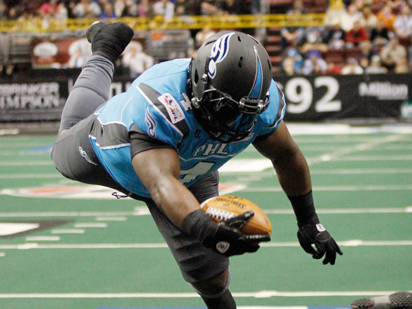 Soul fullback Derrick Ross hurdles over the Cleveland Gladiators´ LaRoche Jackson to score the first touchdown in the first quarter. (Michael S. Wirtz/Staff Photographer)