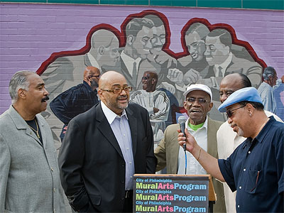 "Current and original members of the Tymes sing ""So Much In Love"" in front of their portion of the mural during dedication at the Trolley Car Diner in Mount Airy. (David M Warren / Staff Photographer)"