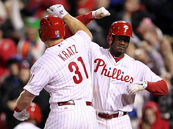 The Phillies´ Erik Kratz and Domonic Brown celebrate Kratz´s three-run home run in the eighth inning. (Yong Kim/Staff Photographer)