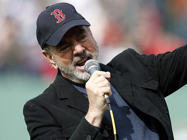 Neil Diamond sings &acute;Sweet Caroline&acute; during the eighth inning of a<br />baseball game between the Boston Red Sox and the Kansas City Royals in Boston, Saturday, April 20, 2013. (Michael Dwyer/AP)