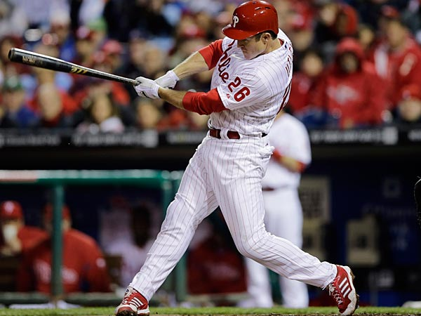 Philadelphia Phillies&acute; Chase Utley follows through after hitting an<br />RBI-single off St. Louis Cardinals starting pitcher Jake Westbrook<br />during the first inning of a baseball game, Sunday, April 21, 2013, in<br />Philadelphia. (AP Photo/Matt Slocum)