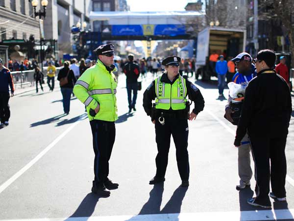 Police stand by near the finish line ahead of Monday´s 118th Boston Marathon, Sunday, April 20, 2014, in Boston. (AP Photo/Matt Rourke)