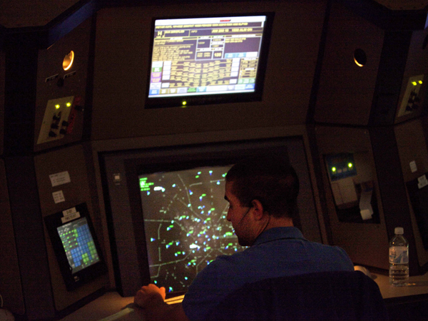 This April 18, 2011, file photo shows an air traffic controller working in a terminal radar approach control room at the Atlanta TRACON in Peachtree City, Ga.  (AP Photo)