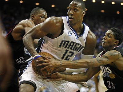Orlando star Dwight Howard will be the center of attention again as the Sixers and Magic meet in Game 2. (Ron Cortes/Staff Photographer)