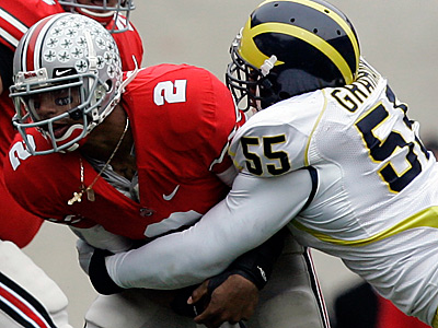 Ohio State´s Terrelle Pryor gets sacked by Michigan DE Brandon Graham. The Eagles moved up 11 spots to draft Graham.  (AP Photo/Kiichiro Sato, File)