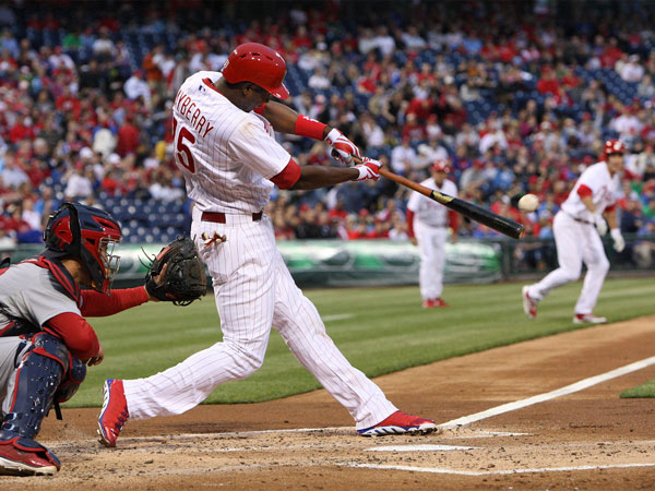 John Mayberry Jr. hits an RBI double against the Cardinals´ pitcher Jaime Garcia during the first inning at Citizens Bank Park in Philadelphia, Thursday, April 19, 2013. (Steven M. Falk/Staff Photographer)
