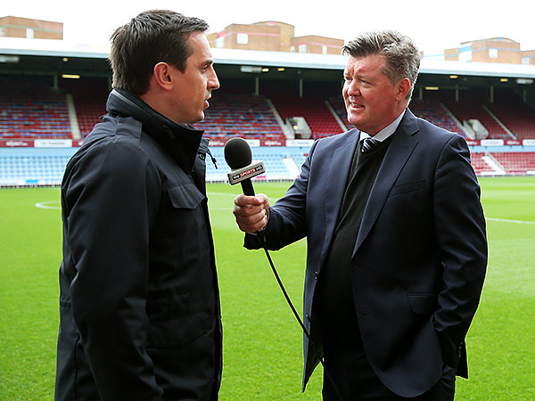 Former Manchester United star defender Gary Neville (left) now works as a television studio analyst for Sky Sports in England. (Julian Finney/Getty Images)