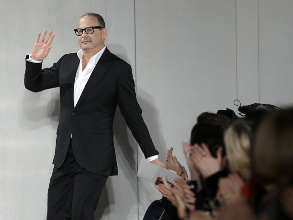 Reed Krakoff greets the crowd after showing hi Fall 2013 collection during Fashion Week in New York, Wednesday, Feb. 13, 2013.  (AP Photo/Seth Wenig)