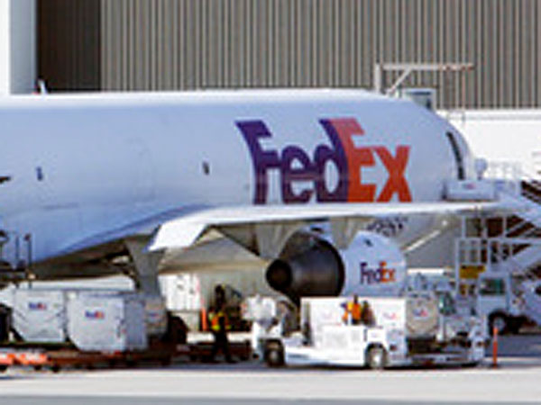 FedEx workers load a plane in Boston in 2008. (Bill Sikes / AP File photo)