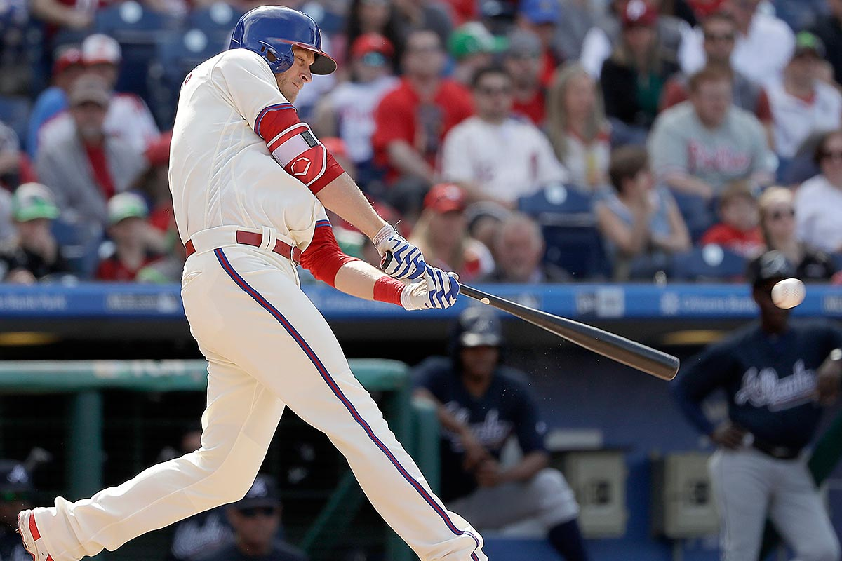 PhilliMichael Saunders hits a lead-off double against the Atlanta Braves.