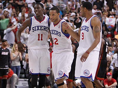 Jrue Holiday, Evan Turner and Andre Iguodala celebrate the victory. (David Maialetti/Staff Photographer)
