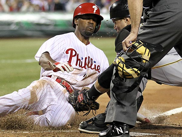 Phillies shortstop Jimmy Rollins gets tagged out at home during Wednesday night´s loss to the Pirates. (Yong Kim/Staff Photographer)