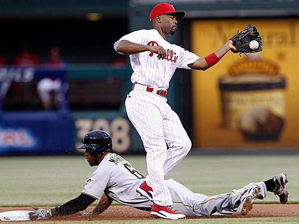 The Phillies´ Jimmy Rollins tries to catch the ball as the Pirates´ Starling Marte steals second base. (Yong Kim/Staff Photographer)