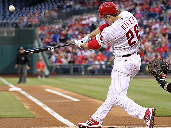The Phillies´ Chase Utley hits a home run in the first inning against the Pirates. (Yong Kim/Staff Photographer)