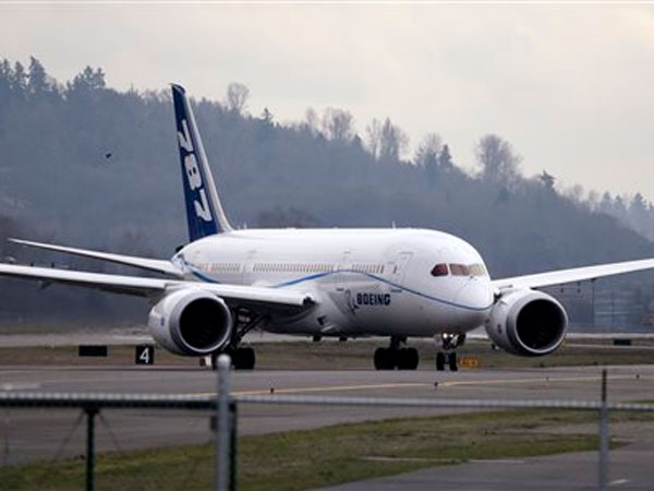 FILE - This Feb. 11, 2013 file photo shows a Boeing 787 jet taxing following a test flight, at Boeing Field, in Seattle. The Boeing Co. reports quarterly financial results before the market opens on Wednesday, April 24, 2013.(AP Photo / Elaine Thompson, File)