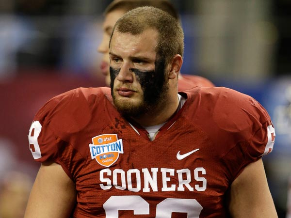 Lane Johnson (69) on the field during warm ups bofore the Cotton Bowl NCAA college football game against Texas A&M Friday, Jan. 4, 2013, in Arlington, Texas. (Tony Gutierrez/AP)