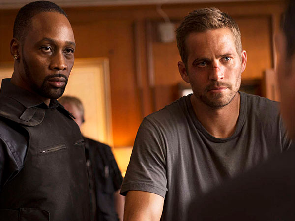 "Jump street: RZA (left) and Paul Walker in the parkour retread ""Brick Mansions."" (Philippe Bosse/Relativity Media)"