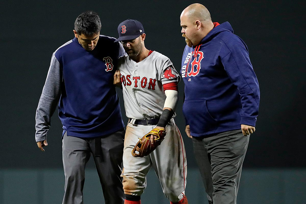 Boston Red Sox second baseman Dustin Pedroia, center, is assisted off the field after being injured during a play in the eighth inning of a baseball game against the Baltimore Orioles in Baltimore, Friday, April 21, 2017.