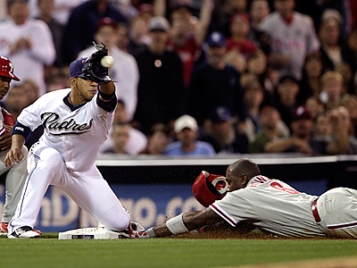 Ryan Howard slides safely into third with a triple. (AP Photo/Lenny Ignelzi)