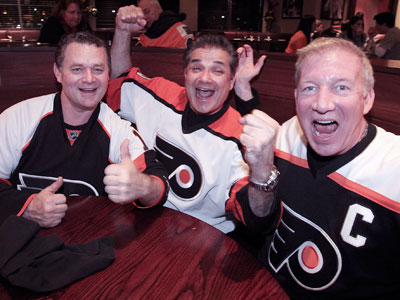 Flyers fans (from left) Ray Fitz, Dr. Rob DiMaio and team captain Joseph Daly sure seem content watching the playoffs at Xfinity Live!