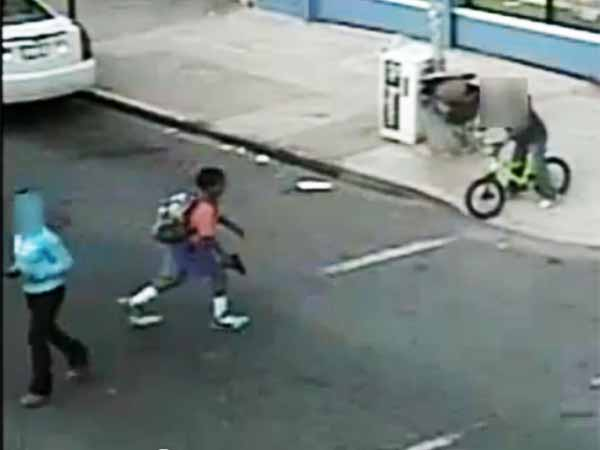 Screenshot from surveillance video released on April 25, 2013 showing a boy with what apears to be a handgun in Philadelphia´s Tioga section.