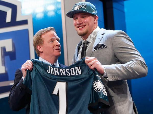 Lane Johnson stands with NFL Commissioner Roger Goodell after being selected fourth overall by the Philadelphia Eagles in the first round of the NFL football draft, Thursday, April 25, 2013, at Radio City Music Hall in New York. (Jason DeCrow/AP)
